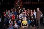 Charlie Brown, Lucy &amp; Linus with Santa &amp; guests in front of a Christmas Tree
