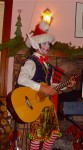 Christmas with Santa&#039;s helper -Elf playing guitar-