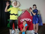 Charlie Brown, Lucy & Linus in front of Snoopy house