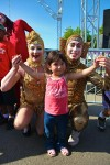 Gold aerialists with a girl