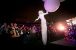 Aerial Balloon-Titan aerialist has landed and surrounded by audiences